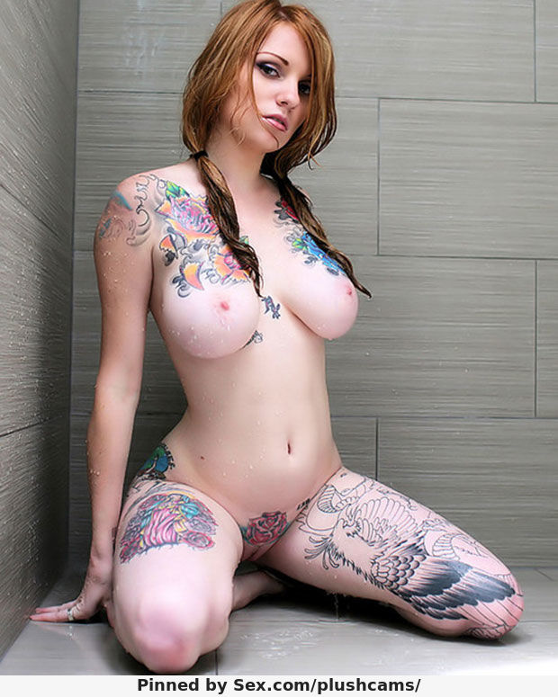 Sexy Tattoo Redhead with Big Tits