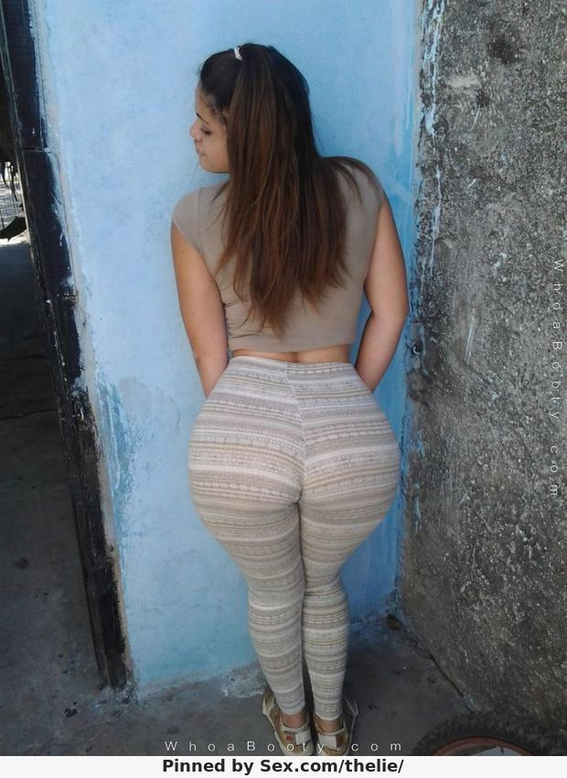 Latina slightly bent over wearing spandex