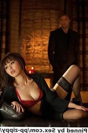 Stocking attired Asian Marika Hase giving handjob and blowjob in high heels