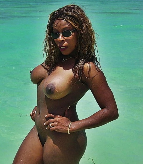 Busty Black MILF at the beach